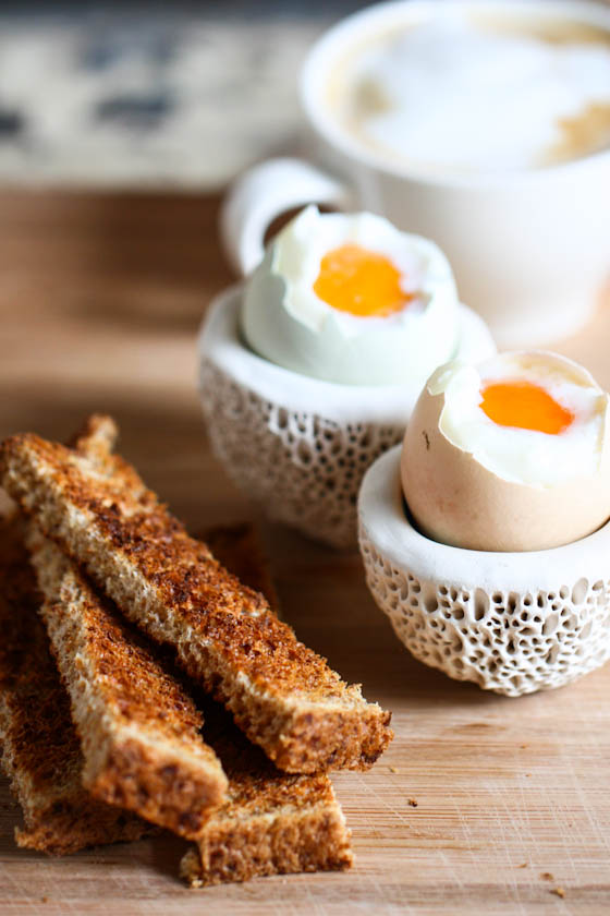 close up photo of soft boiled eggs and toast